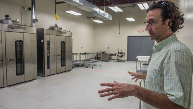 Jeff Grogg, managing director of JPG Resources, shows off some of the ovens used by his company, Snackwerks, for food and snacks manufacturing in Battle Creek.