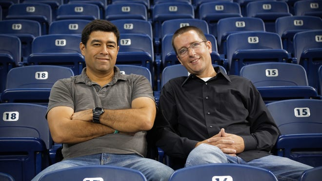Detroit Free Press sports reporters Carlos Monarrez (left) and Dave Birkett