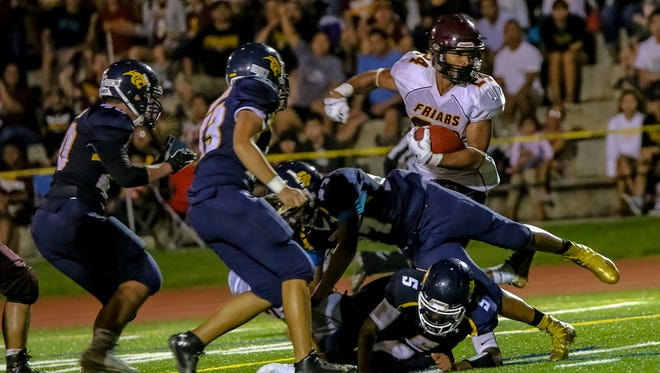 In this file photo, the Father Duenas Friars roll over the Guam High Panthers in an Interscholastic Football League. The league's final regular-season games are this weekend.