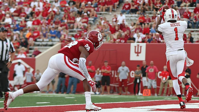 Indiana Hoosiers defensive back AÕShon Riggins (28) trails behind into the end zone as Ball State Cardinals wide receiver Jordan Hogue (1) scores a touch down during fourth quarter action at Indiana University's Memorial Stadium, Bloomington, Ind., Saturday, September 10, 2016. The Hoosiers beat the Cardinals, 30-20.
