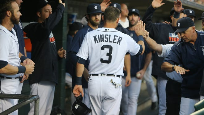 Tigers second baseman Ian Kinsler is met by teammates after scoring during the first inning of the Tigers' 9-6 win over the Twins Wednesday at Comerica Park.