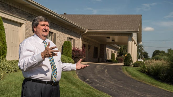 Craig Kempf at the former Shaw Funeral Home in Battle Creek. Kempf will be expanding on the site starting this fall with plans to add more parking and a reception hall on the adjacent property.