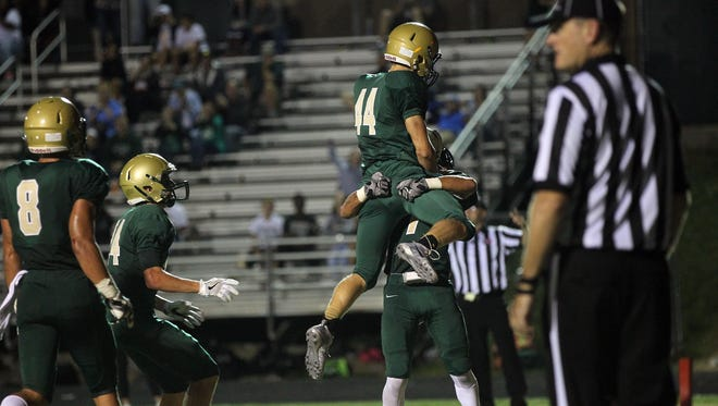 West High's Brennon Keen celebrates his touchdown during the Trojans' game against City High at West High on Friday, Sept. 16, 2016.