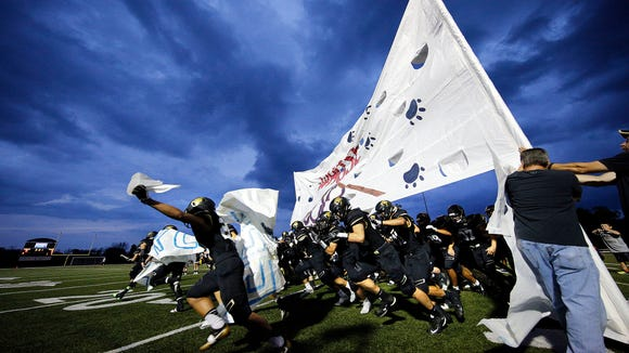 The Franklin football team bursts onto the field before a recent game. They will host archrival Oak Creek in a state playoff game on Friday, Oct. 28.