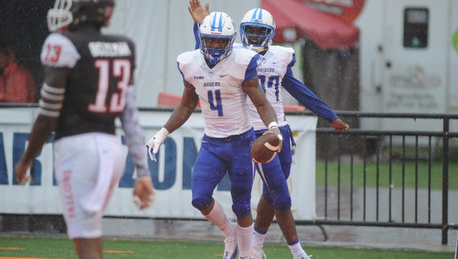Middle Tennessee State's Patrick Smith (37) celebrates I'Tavius Mathers' (4) touchdown against Bowling Green in the second half Saturday, Sept. 17, 2016 at Doyt L Perry Stadium