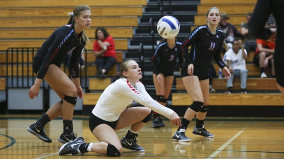 South Salem's Halle James digs the ball in a game on Tuesday, Sept. 6, 2016, at West Salem High School. The West Salem Titans won the match 3-1.