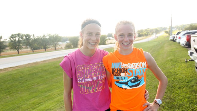Mid-Prairie sisters Anna Hostetler, left, and Marie pose for a photo after practice in Wellman on Tuesday, Sept. 20, 2016.