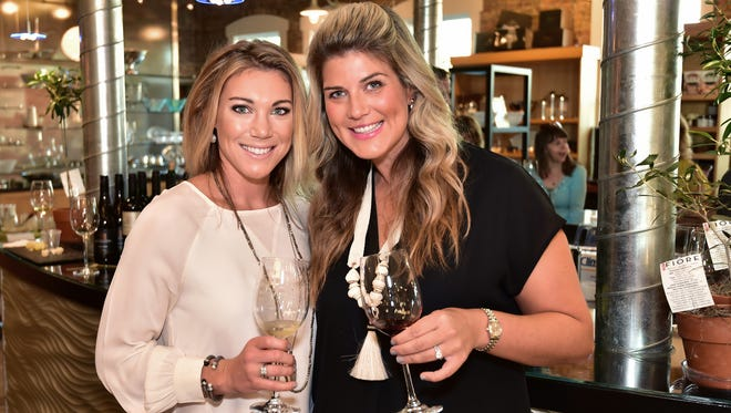 Courtney Martin and Annie Malone enjoy sampling wines at So Gourmet.