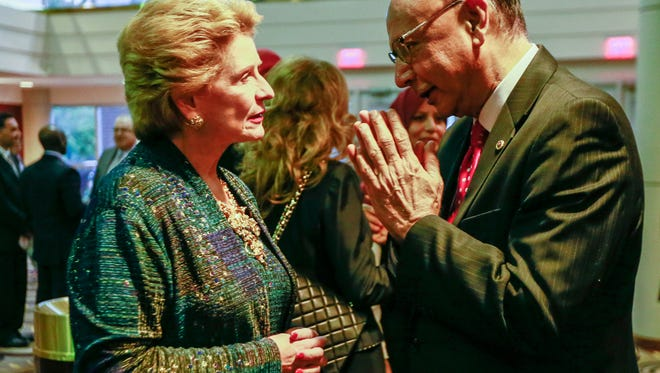 U.S. Senator Debbie Stabenow speaks with Khizr Khan, father of Humayun Khan, who was killed during Operation Iraqi Freedom in 2004, during the Arab American Civil Rights League's fifth annual Fight for Justice Gala at the Ford Community and Performing Arts Center in Dearborn on Thursday, Sept. 29, 2016.
