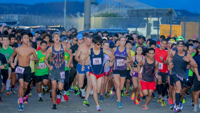 The 15th Annual Strides for the Cure 2K/5K run/walk race was held in Tiyan on Oct. 1. In this photo, the 5K participants take off at the starting line.