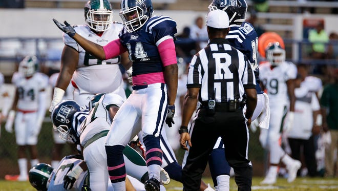 JSU DE Keontre Anderson celebrates after sacking MVSU quarterback Austin Bray.