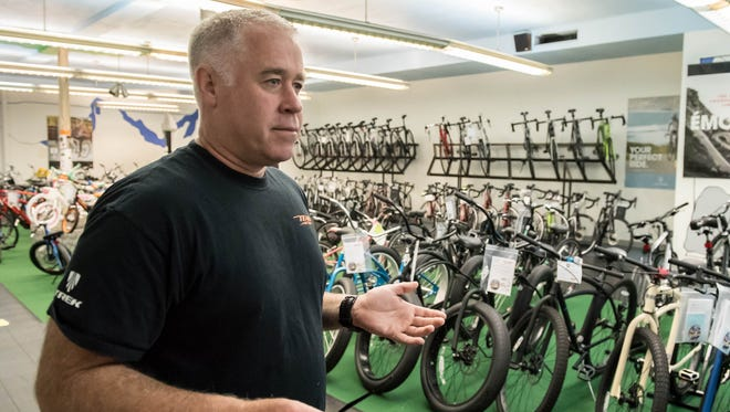 Alan Parr, owner of Trek Bicyle Store (formerally Team Active) talks about his business on Monday.