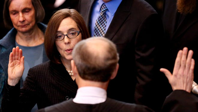 Kate Brown being sworn in as the 38th Oregon governor at the Oregon State Capitol in Salem on Wednesday, Feb. 18, 2015.
