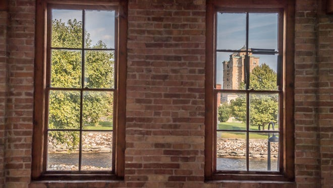 The Carlyle Building at 15 Carlyle St. in Battle Creek has many windows with views of the downtown area, including this one that shows the Hart-Dole-Inouye Federal Center.