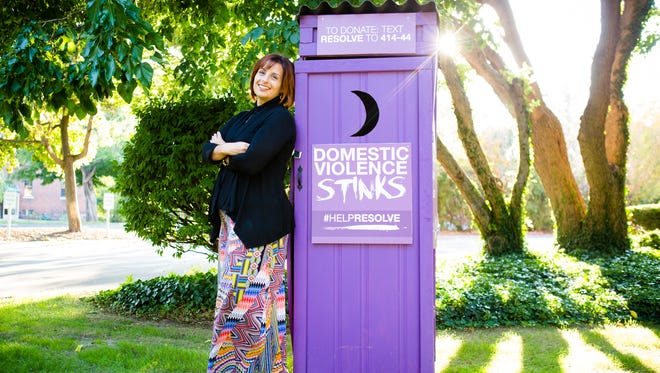 Allison O'Malley is executive director of RESOLVE.The nonprofit is again placing outhouses in front of homes, businesses and colleges during the Domestic Violence Stinks campaign through Oct. 29.