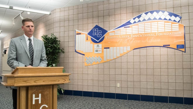 Harper Creek Superintendent Rob Ridgeway speaks during a presentation of the new donor wall (right) at Harper Creek High School Thursday evening.