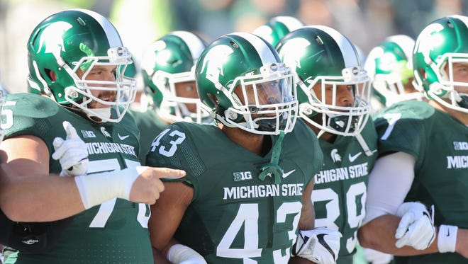 The Michigan State Spartans take the field before a game against BYU on Saturday, Oct. 8, 2016, at Spartan Stadium in East Lansing.