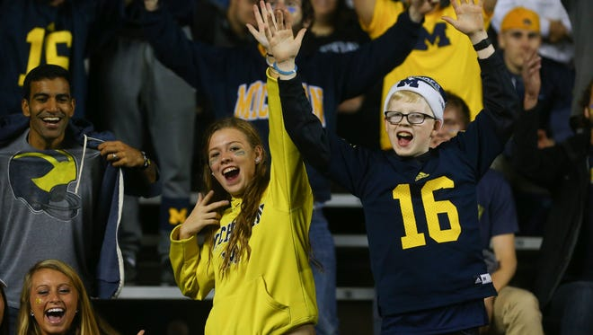 Fans of the Michigan Wolverines cheer during the second half of their game against the Rutgers Scarlet Knights at High Points Solutions Stadium. Michigan defeated Rutgers, 78-0.
