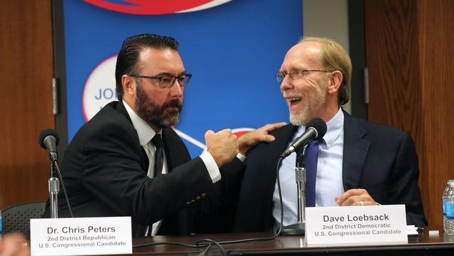 Iowa 2nd Congressional District candidates Christopher Peters, left, and Dave Loebsack joke around during a forum at the Coralville Public Library on Monday, Oct. 10, 2016.