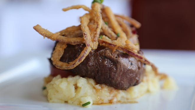 The filet mignon tower from the new lunch menu at The Whitney in Detroit features petite filet atop grilled tomato and whipped potatoes.