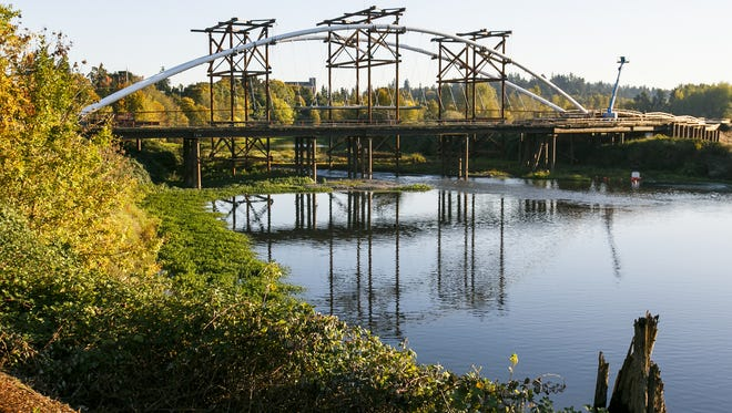 The Peter Courtney Minto Island Bridge spans from Riverfront Park to Minto Brown Island Park. The pedestrian and cyclist bridge was expected to be done by this fall, but now won't open until 2017.