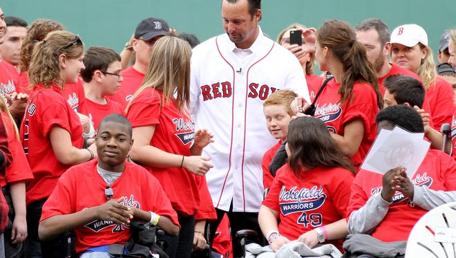 Tim Wakefield, center, with participants in Wakefield's Warriors in 2012. The program brought young hospital patients to Fenway Park to spend time with the award-winning pitcher.