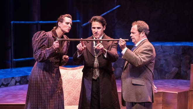 "Cheryl Turski, Ron Williams, and Phil Powers in ""Baskerville: A Sherlock Holmes Mystery"" at Meadow Brook Theatre."