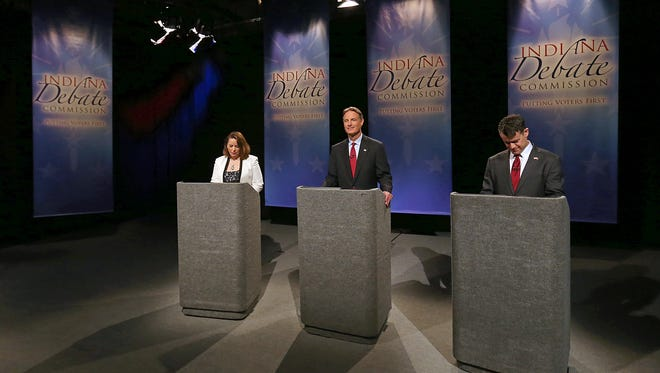 From left, Libertarian candidate Lucy Brenton, Democratic candidate Evan Bayh and Republican candidate Todd Young prepare for the U.S. Senate debate, at WFYI studios, Indianapolis, Tuesday, October 18, 2016.
