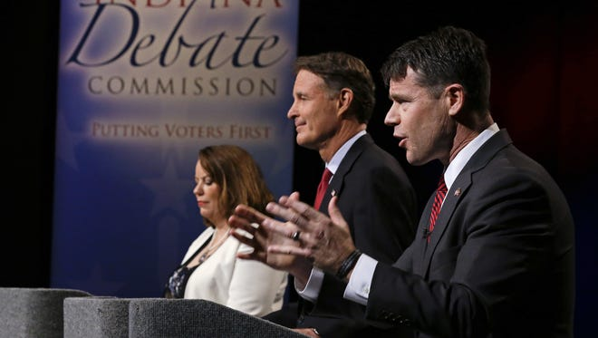 The three candidates for Indiana's open U.S. Senate seat — Libertarian Lucy Brenton (from left), Democrat Evan Bayh and Republican Todd Young — participate Oct. 18, 2016, in a debate in Indianapolis.