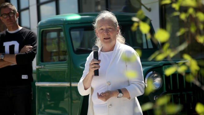 Sue Mosey, president of Midtown Detroit, Inc., speaks during a 2014 ribbon-cutting  ceremony in Midtown.