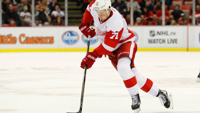 Red Wings center Dylan Larkin skates with the puck in the third period of Friday's win over the Predators.