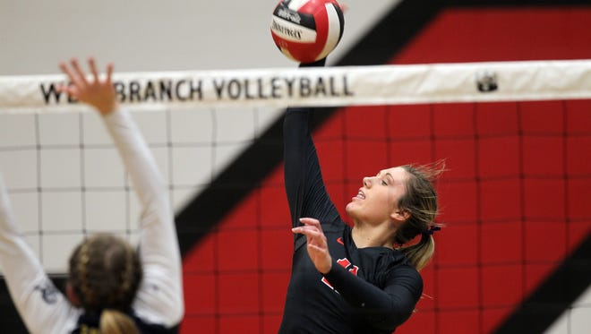 West Branch's Abby Knoop goes for a kill during the Bears' game against Regina in West Branch on Monday, Oct. 24, 2016.