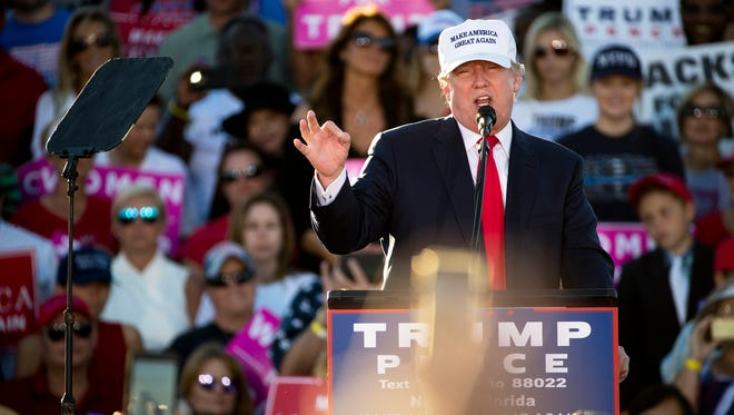 Republican presidential nominee Donald Trump speaks during his rally at the Collier County Fairgrounds Sunday.