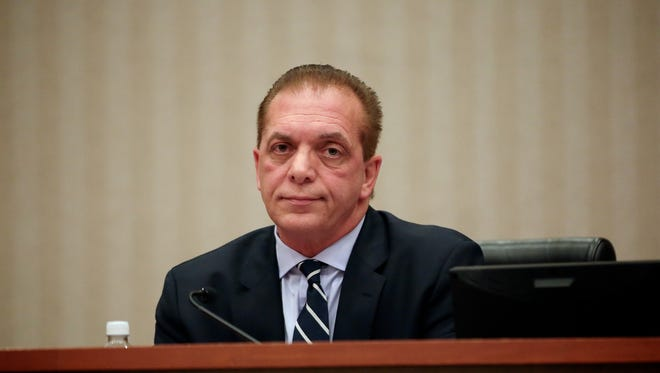 Dino F. Bucci Jr., a Macomb Township Board of Trustees member, attends the meeting at the Town Hall in October 2016 in Macomb Township.