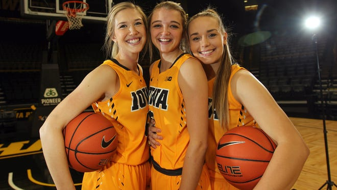 Iowa seniors Hailey Schneden, from left, Ally Disterhoft and Alexa Kastanek pose for a photo during media day at Carver-Hawkeye Arena on Wednesday, Oct. 26, 2016.