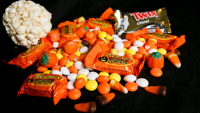 We put together a selection of Halloween treats for Statesman Journal food reporter Brooke Jackson-Glidden to try, including Brach's Mellowcreme Autumn Mix, Reese's Peanut Butter pumpkins, a Twix Ghost and a popcorn ball.