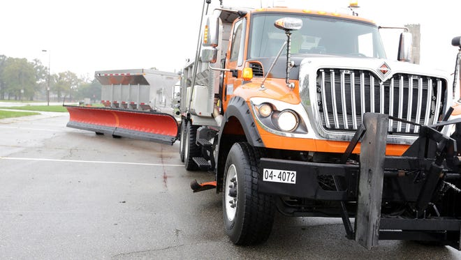 A tow plow, shown Oct. 27, 2016, in Detroit, has a double salt carrier that allows 10 tons to be carried in each container and has the capability to plow 29 feet.