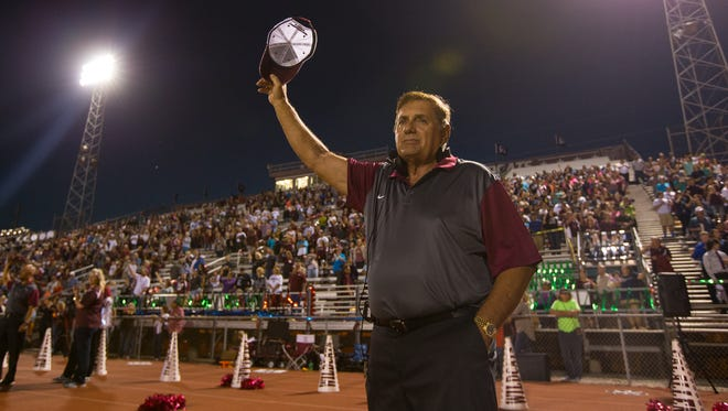 Calallen head coach Phil Danaher holds his hat up during the schools alma mater before their game against Miller at Wildcat stadium, Friday, Oct. 28, 2016.