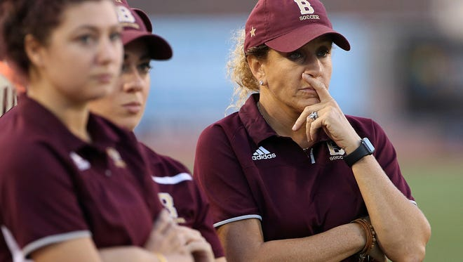 Brebeuf Jesuit Braves head coach Angela Berry White watches gameplay during first half action of Indiana class 2A girls soccer state finals at IUPUI's Carroll Stadium, Indianapolis, Saturday, October 29, 2016.