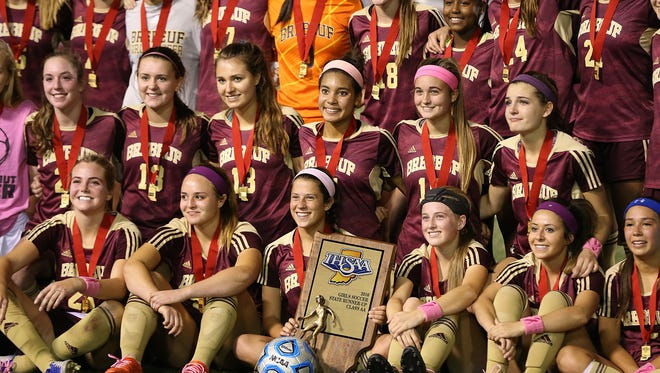 The Brebeuf Jesuit Braves pose for a photo with the runner-up trophy after Indiana class 2A girls soccer state finals at IUPUI's Carroll Stadium, Indianapolis, Saturday, October 29, 2016. Penn High School won, 2-0.