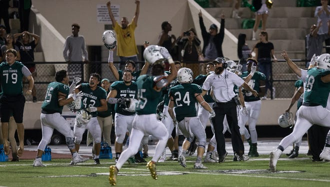 King celebrates after stopping Ray from winning the game on a two-point conversion attempt during the fourth quarter to preserve a 35-34 win at Buccaneer Stadium on Friday, Nov. 4, 2016.