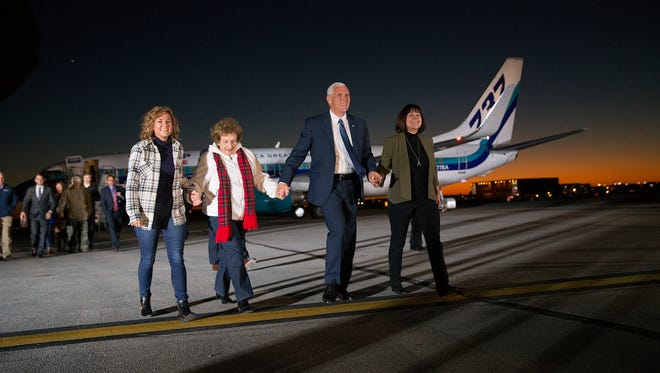 Vice President-elect Mike Pence, his daughter Charlotte, his wife Karen  and his mother Nancy walk toward the crowd after stepping off the plane during a welcome home rally for Pence at the Indianapolis International Airport, Indianapolis, Thursday, November 10, 2016.