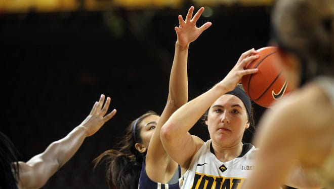 Iowa's Megan Gustafson looks for an open teammate during the Hawkeyes' game against Oral Roberts at Carver-Hawkeye Arena on Friday, Nov. 11, 2016.