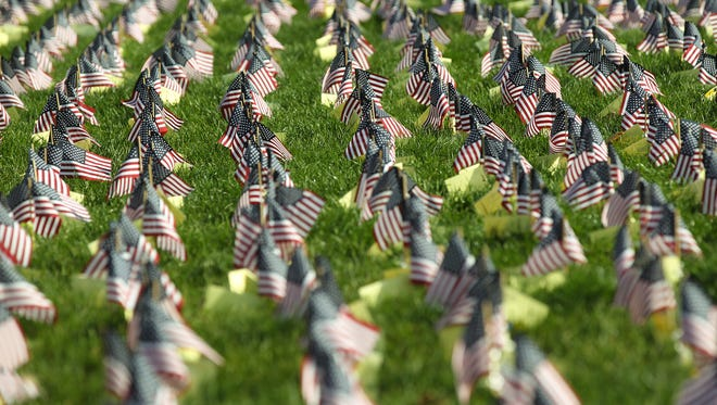 Flags are arranged on the Pentacrest lawn to honor Iowa veterans on Friday, Nov. 11, 2016.