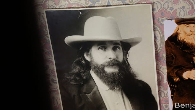 Photos of House of David founder Benjamin Purnell hang inside the House of David Museum in St. Joseph.