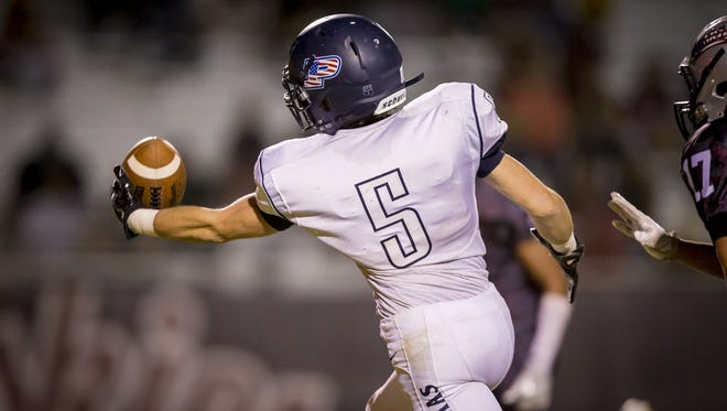 Wide receiver Colby Dickie (5) of Perry makes a one-handed catch in the end-zone for a touchdown in the second half of the high school football game between Perry and Hamilton at Hamilton high school on Friday, October 21, 2016 in Chandler, Arizona.