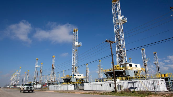 """In this May 18, 2015, file photo, more than 30 oil drilling rigs stood idle in Odessa, Texas. Ken Medlock, director of an energy-studies program at Rice University in Houston, says an assessment Tuesday, Nov. 15, 2016 by the U.S. Geological Survey that the Wolfcamp Shale in the Midland-Odessa region could yield 20 billion barrels of oil is another sign that """"the revival of the Permian Basin is going to last a couple of decades."""""""