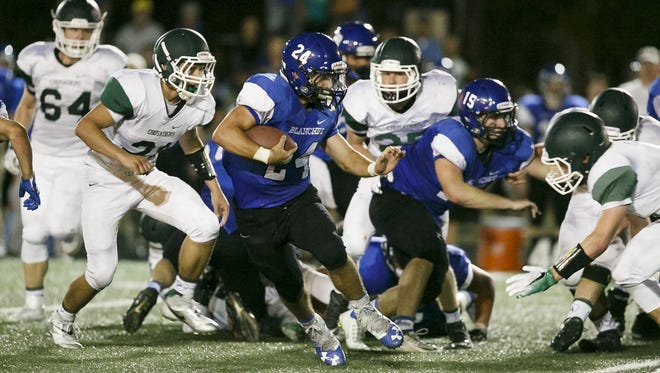 Blanchet's Nicholas Orlandini (24) carries the ball in the fourth quarter of a game against Salem Academy on Friday, Sept. 16, 2016, at Salem Academy. The Salem Academy Crusaders won 14-10 in their first victory over Blanchet since 2011.