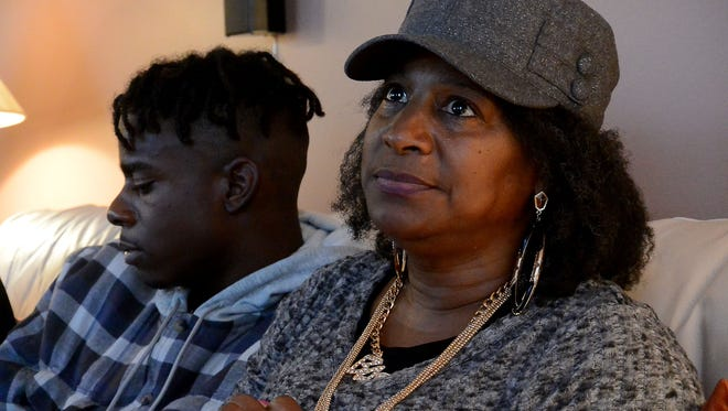 """Najiyyah Avery mourns the July 2 police shooting death of her son Jai """"Jerry"""" Williams at a house in South Asheville days before Thanksgiving. Jai Williams Jr., the deceased's son, sits nearby."""