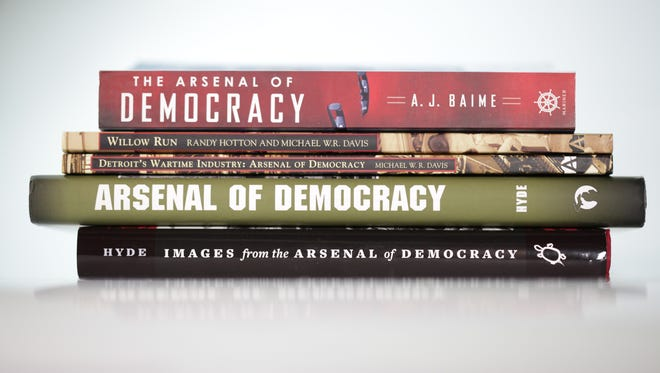 """From top to bottom: """"The Arsenal of Democracy"""" by A.J. Baime; """"Images of Aviation, Willow Run"""" by Randy Hotton and Michael W.R. Davis; """"Images of America, Detroit's Wartime Industry, Arsenal of Democracy""""; """"Arsenal of Democracy"""" by Charles K. Hyde; """"Images from the Arsenal of Democracy"""" by Charles K. Hyde."""